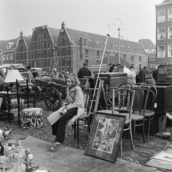 1960's. View of the Waterlooplein in Amsterdam. Waterlooplein is a square in the center of Amsterdam. Waterlooplein was created in 1882 when the Leprozengracht and Houtgracht canals were filled in. In 1893 the square became a daily marketplace when the city government decided that the Jewish merchants in the nearby Jodenbreestraat and Sint Antoniebreestraat had to move their stalls to the square. The market is open every day except Sunday. Photo Cas Oorthuys. #amsterdam #1960 #Waterlooplein