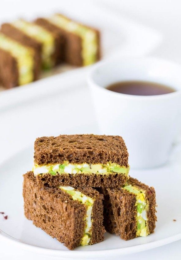 Spicy avocado egg salad sandwiched between chewy pumpernickel bread slices. Perfect texture contrast and flavor combination!  Source: www.sweetandsavorybyshinee.com