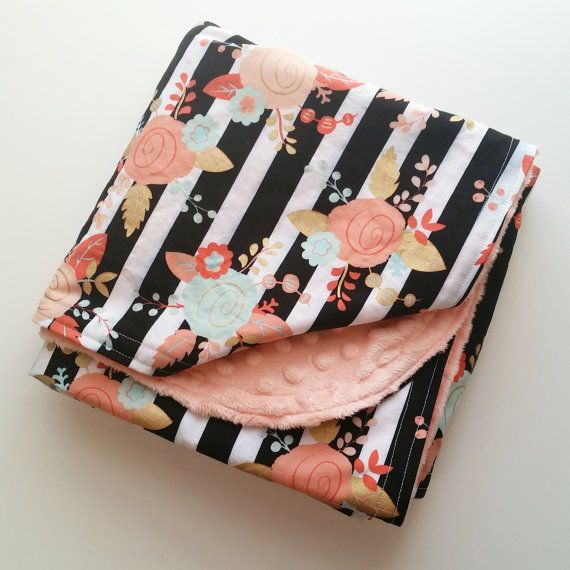Are you searching for that perfect baby blanket for your little girl? Maybe you need a unique, yet useful, baby shower gift for that mom to be. This gorgeous minky blanket is perfect! Black and white stripes detailed with gold, mint and pink flowers atop a soft, luxurious minky make this baby blanket the perfect addition to any nursery. This extra large floral minky blanket is soft and snuggly and plenty big for baby to grow up with. It measures approximately 38 x 27, making it big enough…