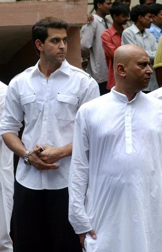 Hrithik Roshan (L) looks on during the funeral ceremony of Indian noted film producer Yash Johar. #Style #Bollywood #Fashion #Handsome