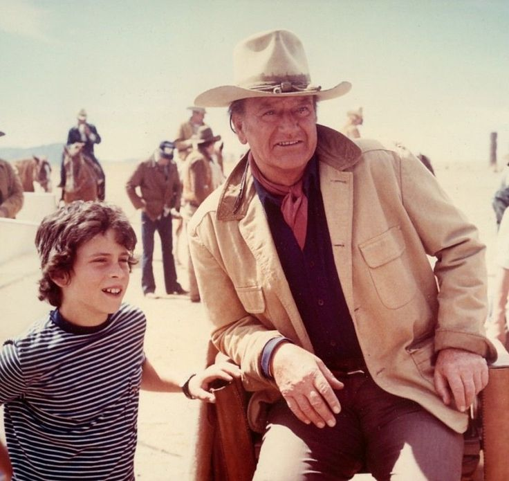 """Ten-year-old Ethan Wayne visits his famous father, actor John Wayne, on the Durango, Mexico set of """"The Train Robbers,"""" an underwhelming western directed by Burt Kennedy and released by Warner Bros. on February 7, 1973. (Image Credit: Photography by David Sutton)"""
