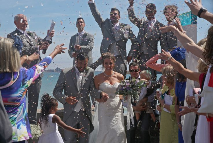 Andrew and Claire under the confetti at their #wedding in Jersey, UK, August 2016. For more #photography see www.lucymunday.com
