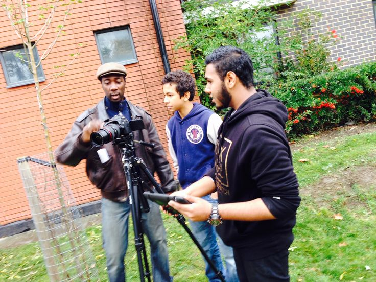 Professional Filmmaker teaching the young people how to use a camera