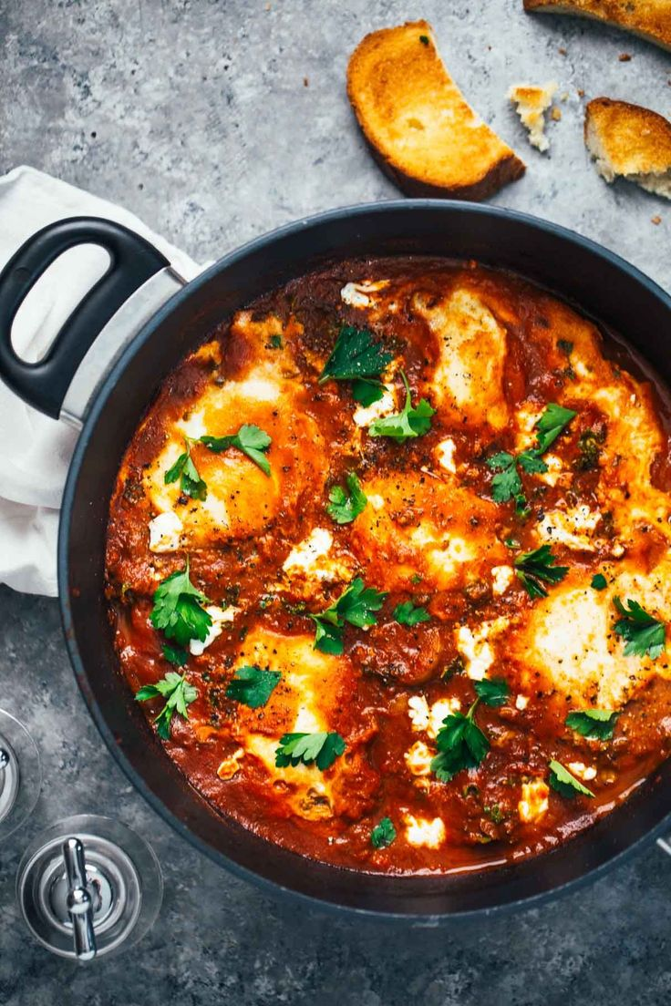 One-Pot Spicy Eggs and Potatoes with a homemade tomato simmer sauce, kale, potatoes, eggs, and creamy goat cheese! 350 calories.