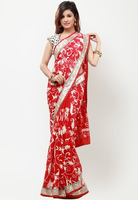 BARCODE 91 Embellished Red Saree - A red coloured saree for women by Barcode 91. Made from chiffon, this embellished and embroidered saree measures 6.3 metres, including a blouse piece. It comes with an additional stitched blouse measuring 39.5 inch (large).