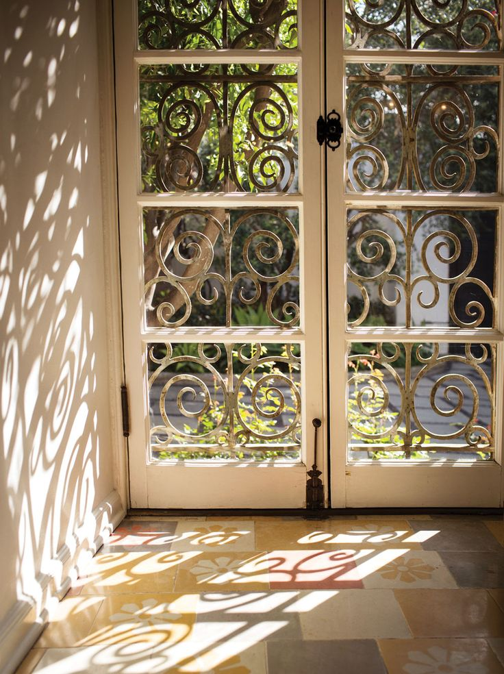 Nice French Doors With Wrought Iron Security.