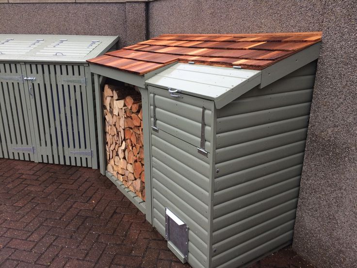 Combination set with triple bin store, log store and coal bunker,treated in Sadolin and topped with a Cedar Shingle roof.