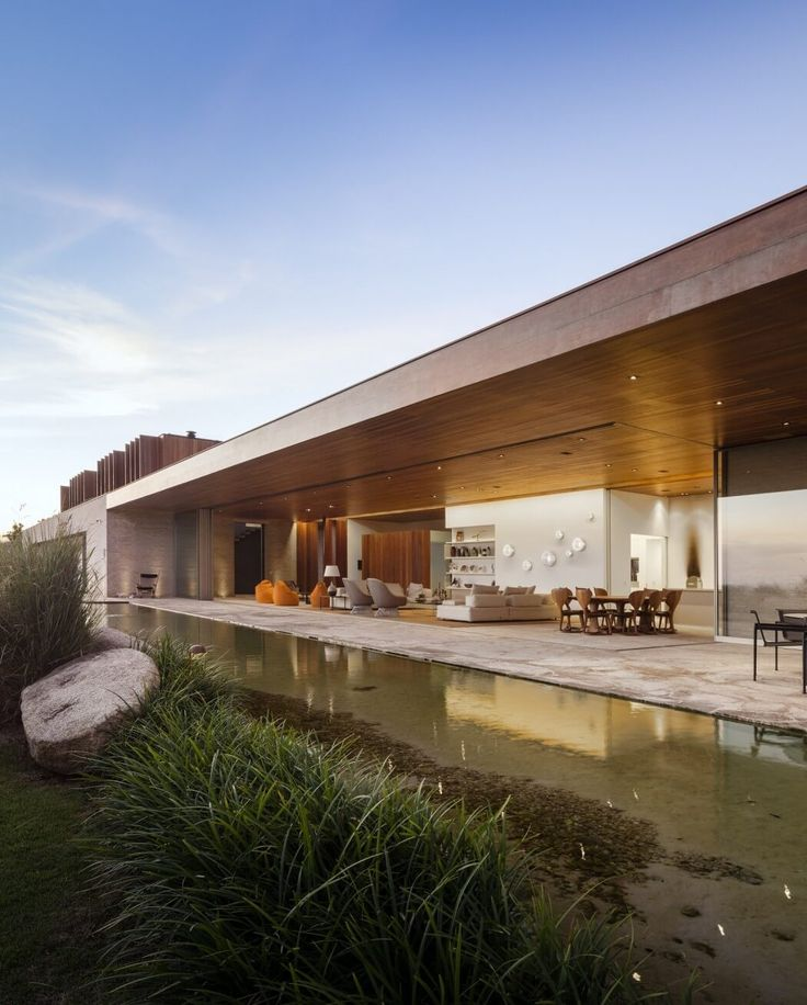 Modern Summerhouse Opens Up to Large Terrace and Pond in Brazil - http://freshome.com/modern-summerhouse-Brazil/