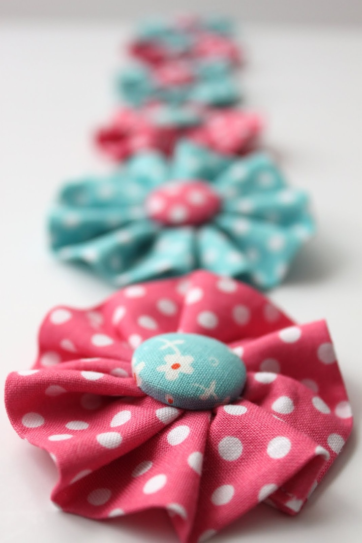 Hair clips - use a covered button for the center and a rectangle strip, gathered on one side, for the outer circle...just the idea I needed to use my fabric scraps!