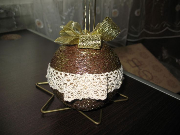 brown and gold christmas ball with crochet