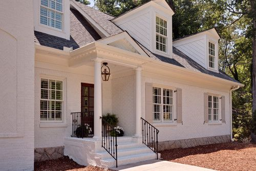 Painted brick houses: paint color is Benjamin Moore White Dove, the trim is also White Dove, and the shutters are BM Revere Pewter.