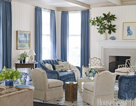 "Blue-and-cream living room. The velvet on the love seats ""is great because it feels already worn-in,"" designer Ann Wold says."