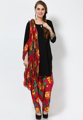 A black coloured suit set for women from Alma. Made from cotton, this suit set consists of a salwar, kameez and a dupatta. Spruce up your ethnic look for the day wearing this black coloured suit set from Alma. Beautifully designed, this suit set will lend you a look worth flaunting. Featuring an all-over pintuck pattern and floral printed salwar, this set is a must-have for women who want to experiment with their ethnic look.