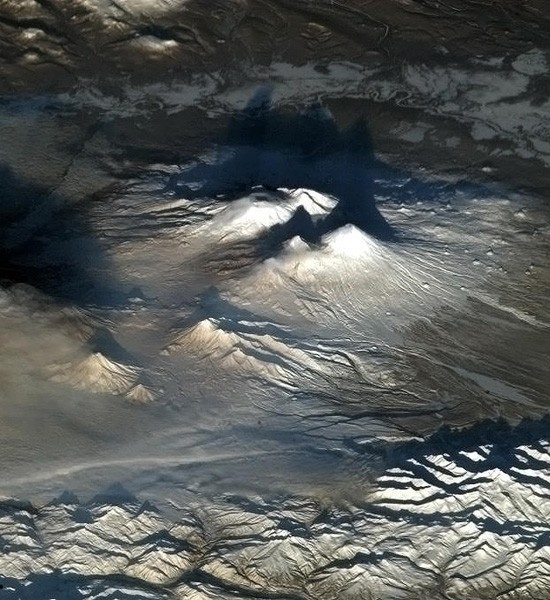 "On Jan. 6, Canadian Space Agency astronaut Chris Hadfield captured this photo from aboard the International Space Station and tweeted, ""Volcanoes look dramatic at dawn."