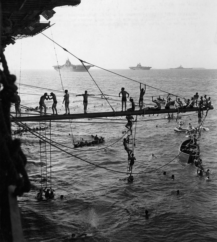 Crewmen of a U.S. Navy aircraft carrier banish post-battle nervous strain by taking a swim in the warm waters of a lagoon in the Marshalls only a few days after laying siege to and conquering Roi Island in the Kwajalein atoll. (1944) [2048 x 2283]