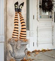 Witch Legs Halloween Urn... This witch made a crash landing on your