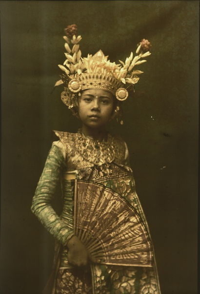 """National Geographic: A nine-year old dancer in her gilded crown and costume."""