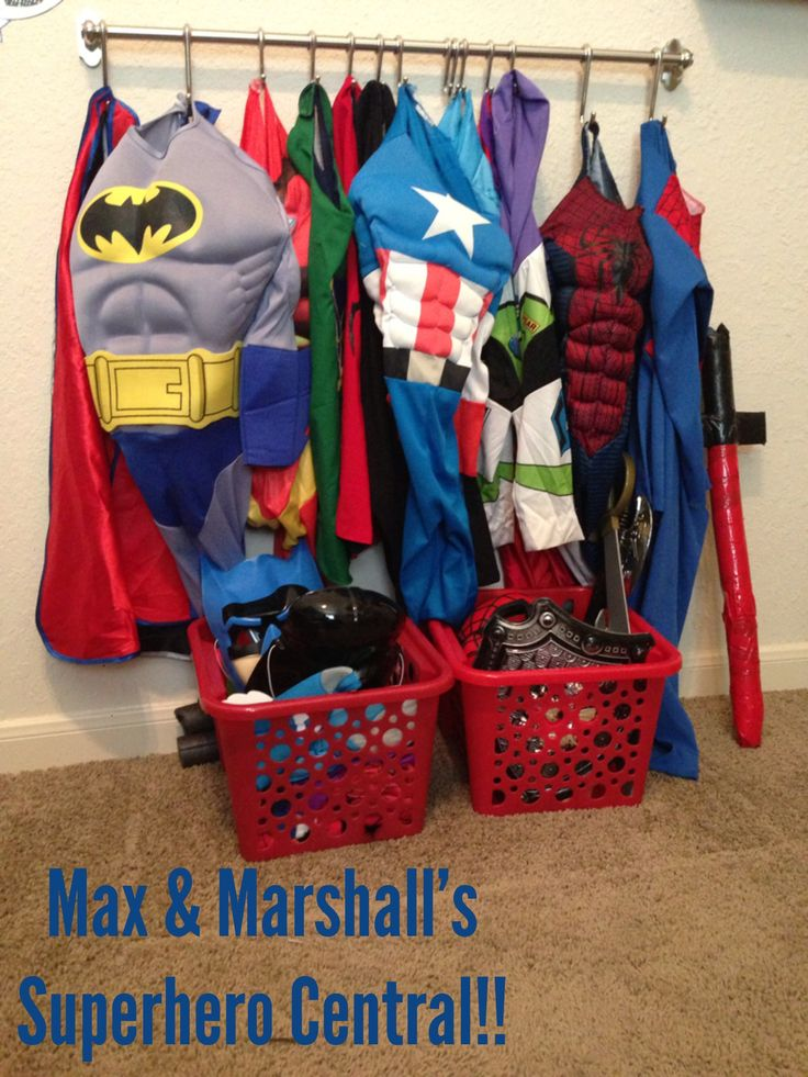 Superhero dress up area using rod and hooks from ikea wall hanging system only cost like 15 bucks total! Kids can get costumes on and off easily and works so much better than having their costumes all over the floor !!