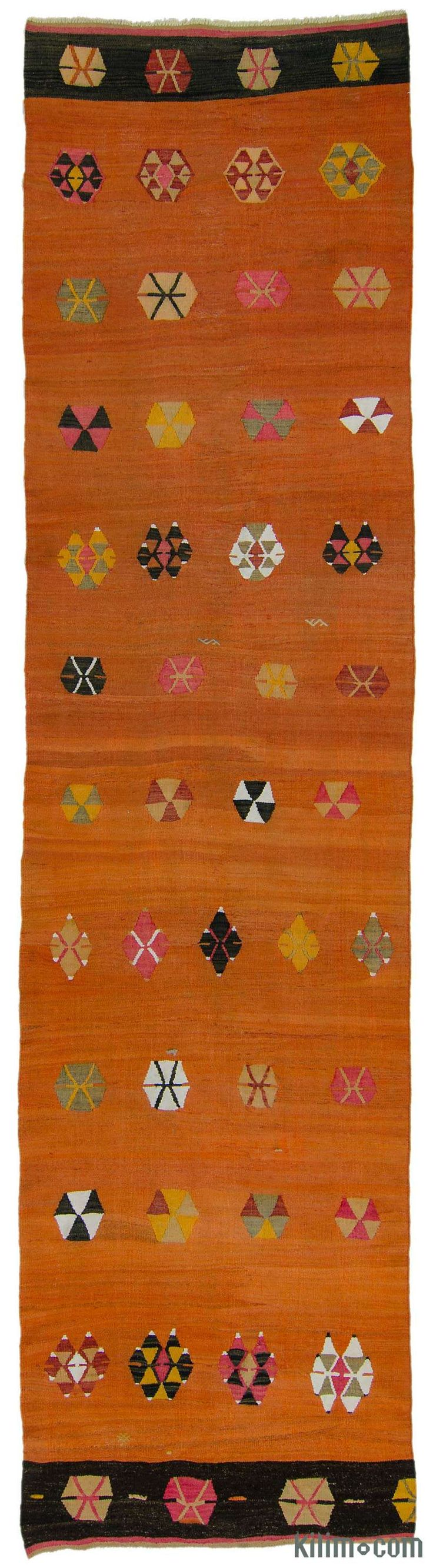 Vintage tribal Turkish kilim runner rug around 70 years old. This kilim runner was hand-woven in the Sivas region of Central Anatolia, Turkey.
