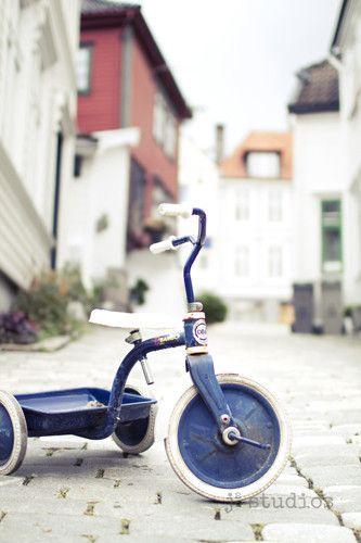 blue tricycle art print bergen norway photography europe j2 studios larry jang cobblestone streets nursery decor boy room fishermens houses trike Scandinavia