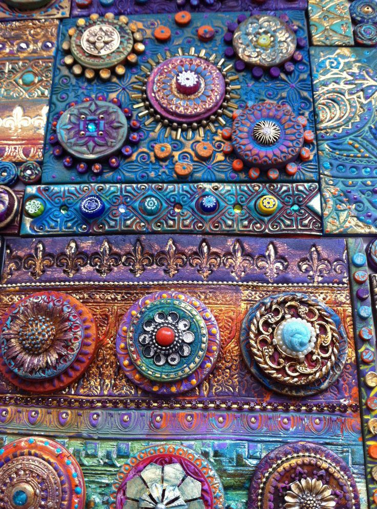 Laurie Mika. Piled on the layers of polymer, stamps, paints, metallics, inks, buttons and jewels to achieve a whole new level of splendor. This mosaic was inspired by the Indian sari trims Laurie found on her recent trip to Sydney