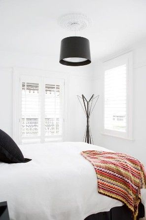 T01 Architecture - Projects - Paddington bedroom white colourful throw black lightshade white shuttered windows