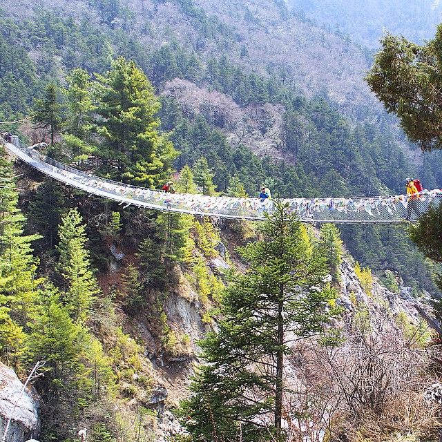 : Phakding, Nepal -------------------------------------------- Nepal week continues: If you like suspension bridges and Indiana Jones & the Temple of Doom, you're gonna love the trek to Everest Base Camp from Lukla. You'll criss-cross probably 20 sketchy suspension bridges across the river valley. Due to the quake Nepal needs your help. If you'd like to donate, contact the Nepal Red Cross at NRCS.org #thetravelbuggers #prayfornepal ---------------------------------------------