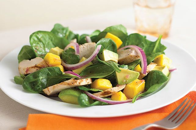 Creamy avocados and crisp baby spinach are the perfect complement to juicy mangoes and hearty chicken in this refreshing salad.