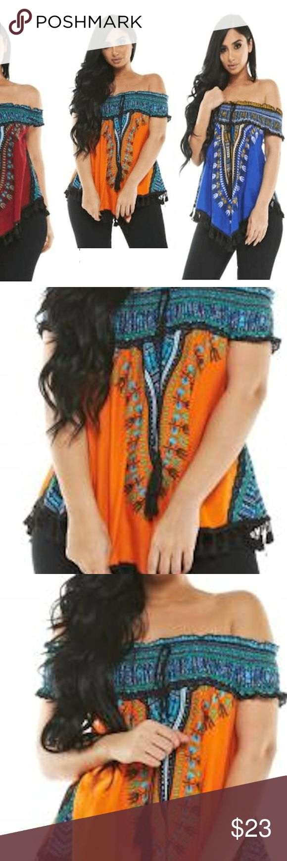 """NEW DASHIKI FRINGE TOP BLOUSE SHIRT ORANGE ORANGE SUPER CUTE AND TRENDY DASHIKI TOP. THIS LISTING IS FOR THE BLACK ONE; IF WANT THE ORANGE ONE, CHECK OTHER LISTINGS. SEXY OFF THE SHOULDER TOP WITH SLIMMING V HEM LINE. GORGEOUS COLORS. THESE CAN BE WORN ON OR OFF SHOULDER AND ARE A LOOSE FIT SO EACH SIZE COULD ALSO FIT ONE SIZE UP. MEASURES APPROX. 25"""" WITHOUT FRINGE FROM CENTER OF NECK TO CENTER OF BOTTOM.  95% POLY 5% SPANDEX LOOSE, FLOWY FIT I DO NOT INFLATE MY PRICES SO DON'T HAVE ALOT OF…"""