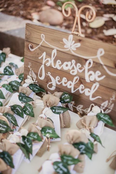 """For an outdoor wedding, """"please be seeded"""" with names written on leaves attached to table numbers and bags of seeds ~ http://www.stylemepretty.com/vault/gallery/38796"""