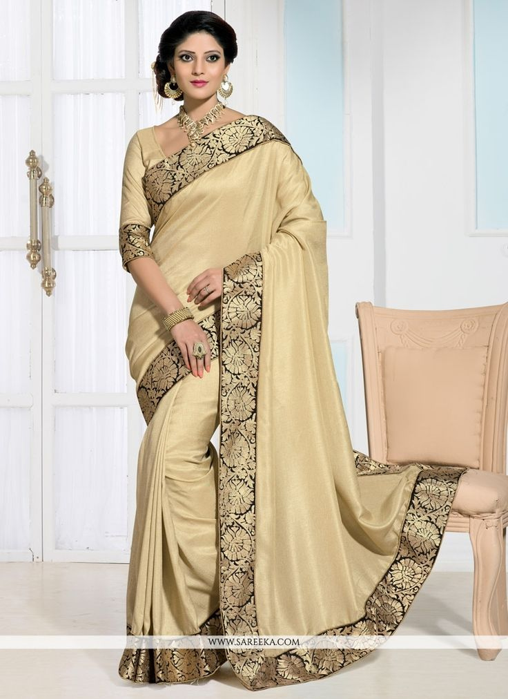 Latest cream designer saree is create with zari, shimmer border work makes this indian apparel to die for. Comes with matching blouse. (Slight color variation is possible.)...
