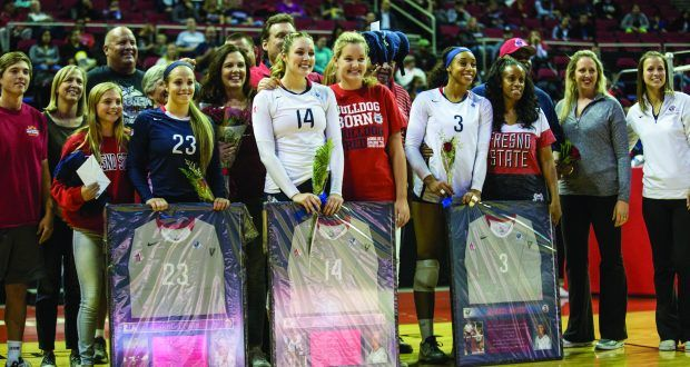 From left: Seniors Maggie Eppright (#23), Brooke Legeaux (#14) and Aleisha Coates (#3) are recognized at the Save Mart Center for Senior Salute Night before Wednesday's game against the Utah State Aggies. (Khone Saysamongdy/The Collegian)