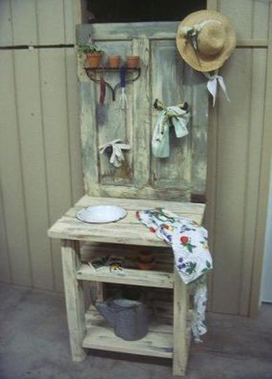 Potting bench created using an old door. Notice the rake head that is being used as a shelf. This idea could also be used as a bar. Maybe wine glassed could be hung from the rake head. Used as a bar it would be nice used outside on a deck for entertaining!