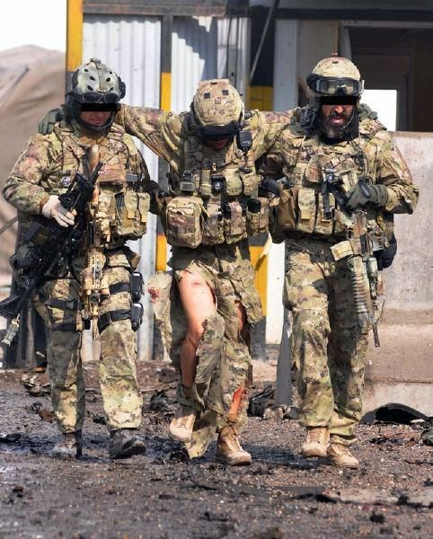 Italian Task Force 45 - Afghanistan. Two members of Caraninieri's GIS with one of the GOI after a battle with insurgents
