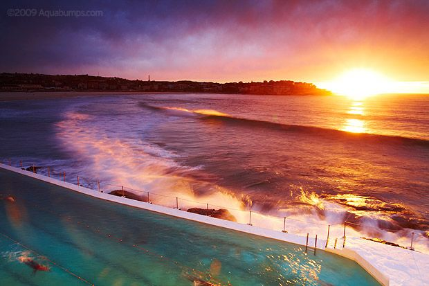 Sunrise over the pool at Icebergs, Bondi Beach, Australia.