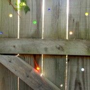 Fence + Marbles = Awesome  drill holes and insert marbles!