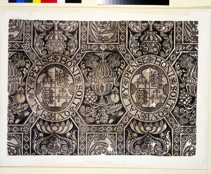 Portion of wallpaper with a pattern of panels containing the arms of England, Tudor roses, vases of flowers and masks; Woodblock print, on paper.