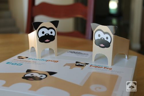 Paper pugs! We got our flyers back from the printer and I assembled a couple pugs. Now I just need to ship these off (the flyers - you are on your on for assembling pugs) to DFW Pug Rescue for their October event (see previous post for a link if you are interested in the details).
