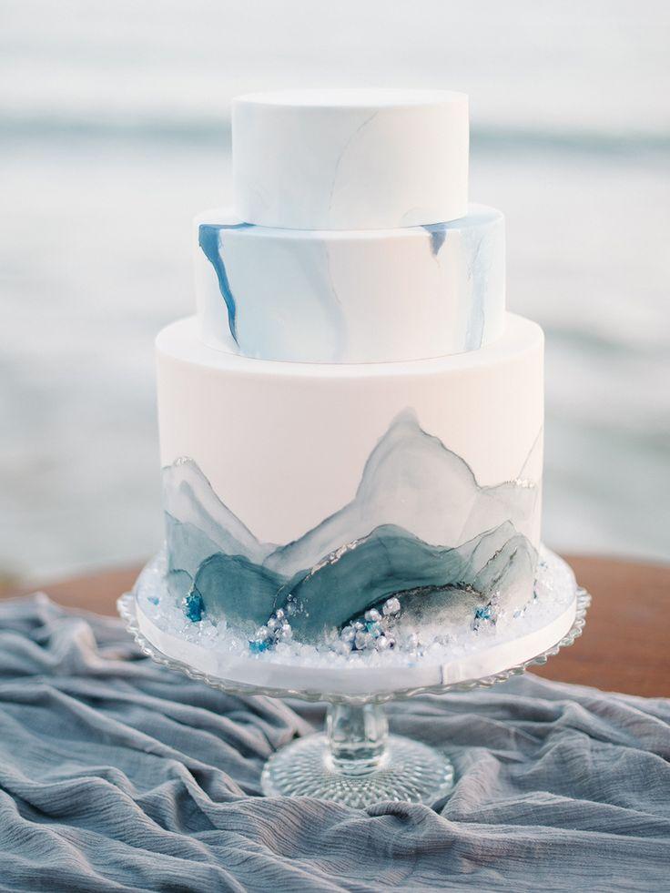 wedding cake with blue accents - http://ruffledblog.com/malibu-coastal-bohemian-wedding-inspiration #weddingcake #cakes