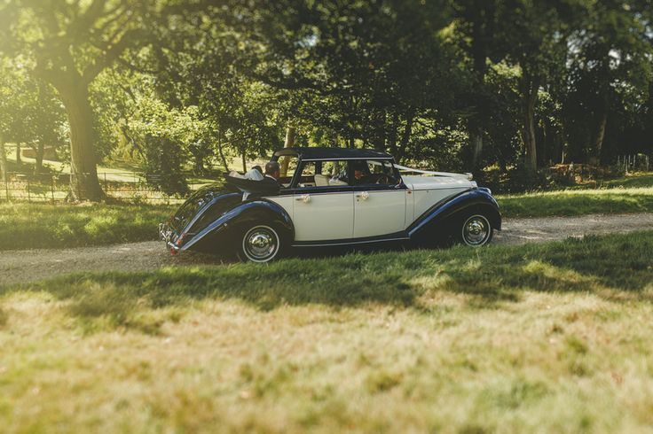 On the way to the wedding in a classic car. Photo by Benjamin Stuart Photography #weddingphotography #wedding #classiccar #weddingcar #weddingtransport