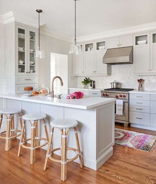 Three Serena Lily Riviera Backless Stools Sit At A Light Gray Wainscot Kitchen Peninsula Fitted Wit Kitchen Design Small Kitchen Remodel Small Kitchen Layout