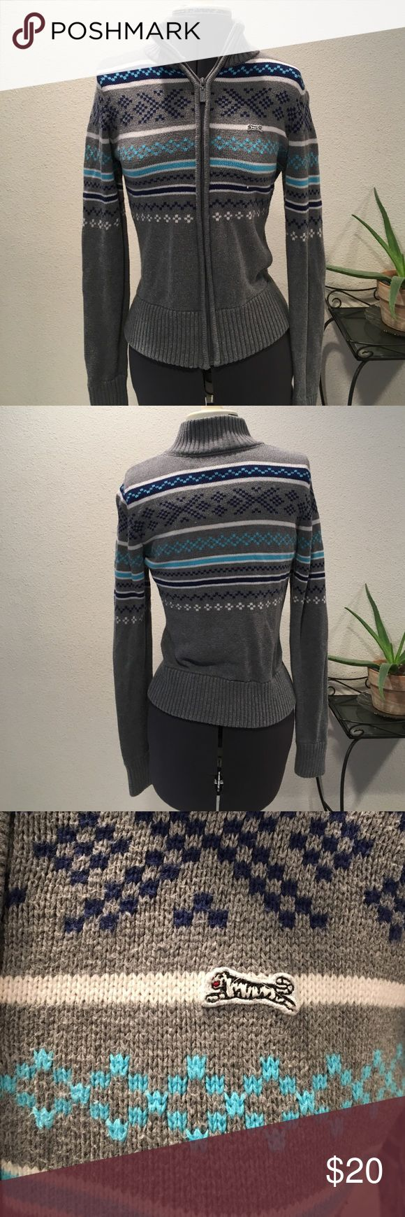 Winter Zip Up Sweater Le Tigre Winter sweater in gray with blue and white stitching :) 100% cotton. Good loved condition. Size Large in Juniors (not Women's sizing) Sweaters