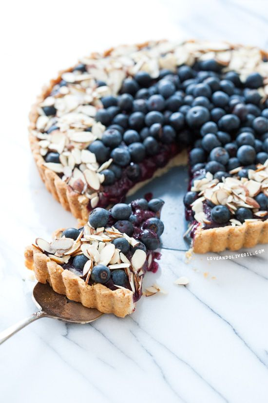 Blueberry Almond Tart (Love & Olive Oil). The filling is basically a blueberry curd, thickened with both egg yolks and cornstarch. Looks and sounds reeaally good!