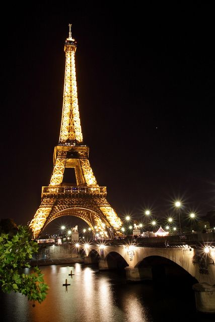 The Eiffel Tower at night is truly a sight to see.