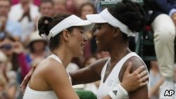 Spain's Garbine Muguruza greets Venus Williams of the United States at the net after winning the Women's Singles final match on day twelve at the Wimbledon Tennis Championships in London, July 15, 2017.