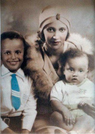 A young Harry Belafonte, left, with his mother and sibling