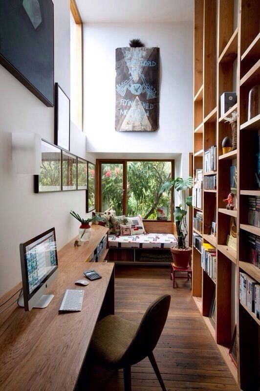 A work desk with floor to ceiling library AND a reading nook? Perfection!