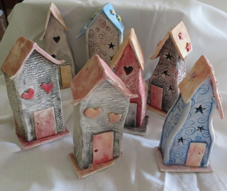 Ceramic houses. I have a passion for houses & am still wanting to do a class using them in various ways. At this time I was going through a ceramics phase & had loads of fun making these crooked houses. I like the unglazed  finish, which gives it a muted 'earthy' finish
