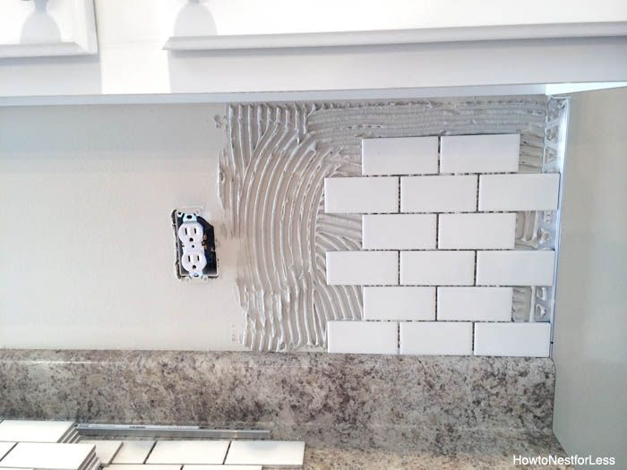 Subway tile backsplash DIY tutorial. Use Grout Boost or other additive - which includes sealer - instead of water to mix the grout.