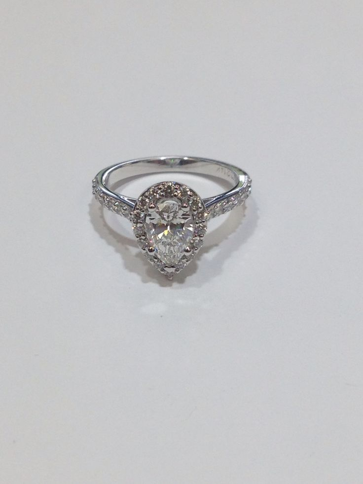 Pear shape halo engagement ring. www.abrahamsjewellery.com
